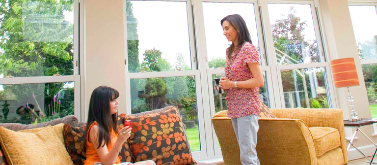 A bright conservatory with nice decor and family enjoying the space