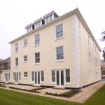 Large building with many vertical sliding sash windows