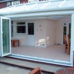 uPVC bifold doors on polycarbonate conservatory