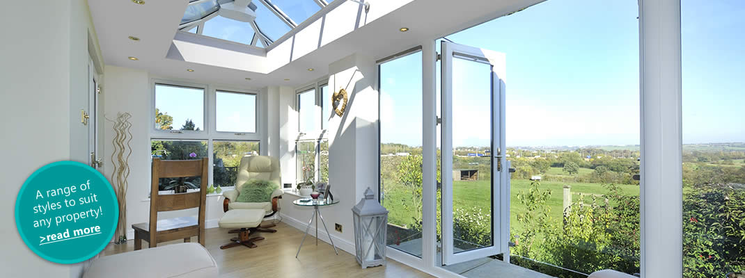 A large white orangery used as living room